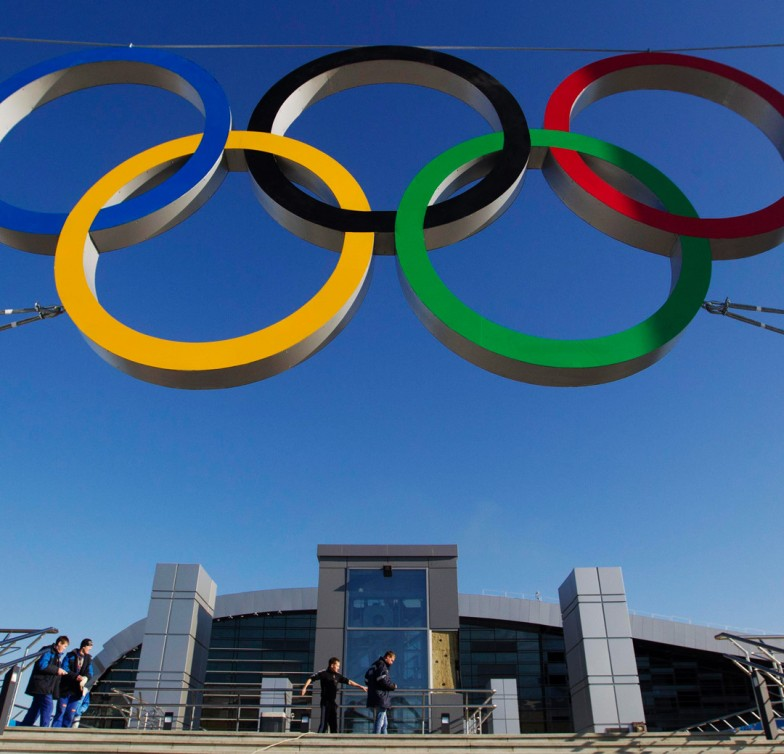 Image: The Olympic rings are on display in front of a newly-built railway station in Sochi